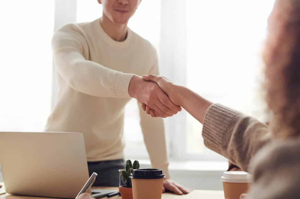 Two people shaking hands after a successful job interview